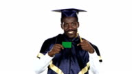 Graduate holding a green card. White. Close up video