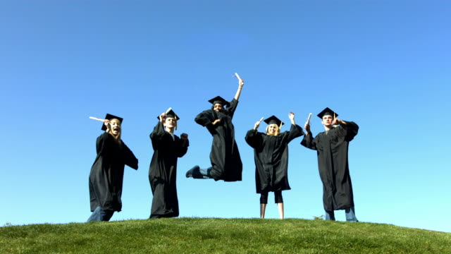 Graduates jumping and celebrating, slow motion video