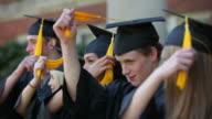 Graduates move tassels and celebrate video