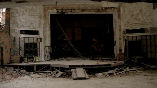 CLOSE UP: Graffiti adorn ruined theatre stage in abandoned City Methodist Church video