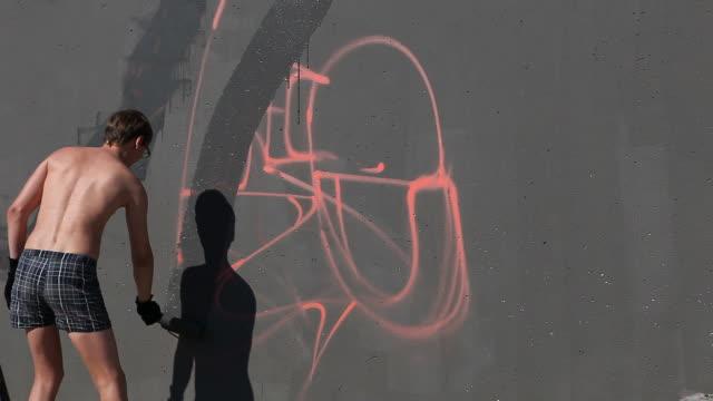Graffiti artist draw paint on wall (HD) video