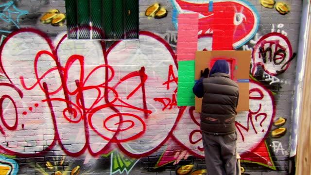 Graffiti Artist Painting Urban Wall using Stencil video