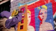 Graffiti Artist Paints with Stencil video