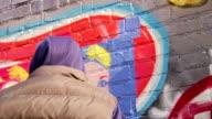 Graffiti Artist Paints with Stencil - CU video