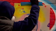 Graffiti Artist Removes Stencil from Wall video