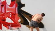 Graffiti artist spraying paint on wall (HD) video