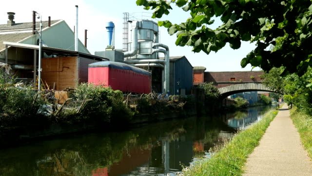 Grand Union Canal, Birmingham, factory and bridge. video