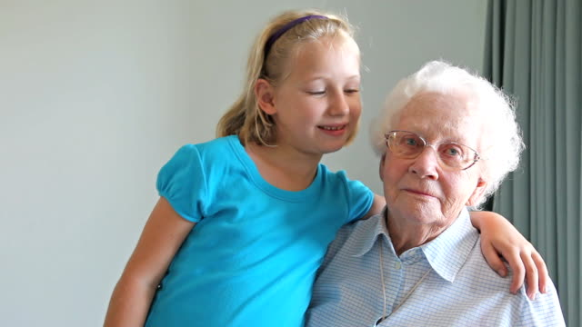 Grandaughter with arm around her Grandmother video