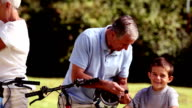 Grandchildren and grandparents riding bike video