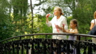 Granddaughter and grandmother on a bridge video