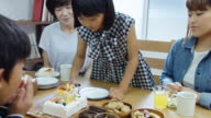 Granddaughter Serving Cake to Family video