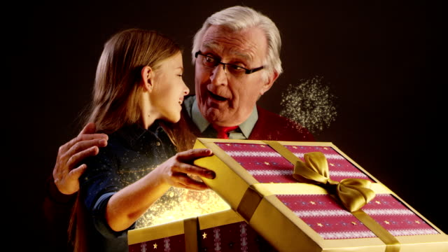Grandfather and grandchild opening Christmas gift video