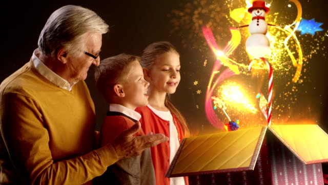 Grandfather and grandchildren opening Christmas gift video