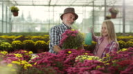 Grandfather and granddaughter at greenhouse video