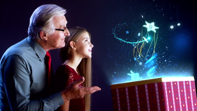 Grandfather and granddaughter opening Christmas gift video