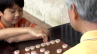 Grandfather and Grandson Chinese Chess Slow Motion video