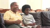 Grandfather And Grandson Watching Television Together video