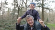 Grandfather Carrying Grandson On Shoulders During Walk video