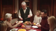 Grandfather carving and serving the Thanksgiving turkey video