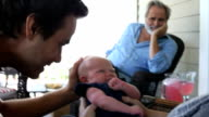 Grandfather, Father, Mother and Baby on porch video