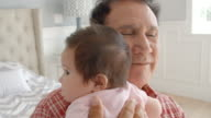 Grandfather Holding Baby Granddaughter In Slow Motion video