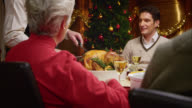 SLO MO grandfather passing the turkey slices at Christmas table video