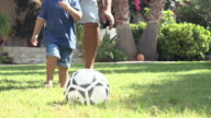 Grandfather Playing Football With Grandson In Garden video