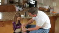 Grandfather puts bandage on granddaughter's knee video