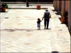 Grandfather walking with little girl video