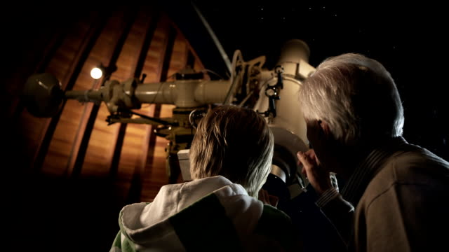 Grandfather with Grandson in observatory video