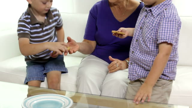 Grandma and boys having cookies video