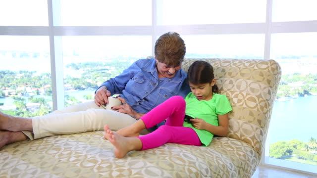 Grandma and Granddaughter on Sofa video