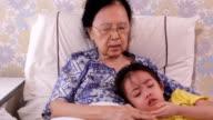 Grandma comforting her crying granddaughter video