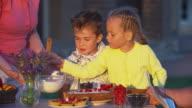 Grandma Teaching Kids to Cook Dessert video