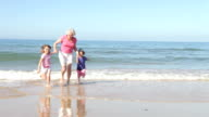 Grandmother And Grandchildren Playing On Beach video