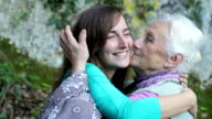 Grandmother and granddaugh giving each other a cuddle full of love and affection video