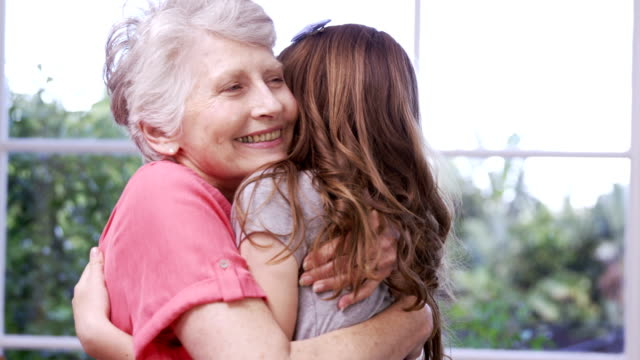 Grandmother and granddaughter embracing video