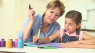 Grandmother Drawing Picture With Granddaughter At Home video