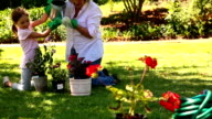 Grandmother gardening with her granddaughter video