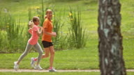 SLO MO TS Grandmother jogging in park with granddaughter video