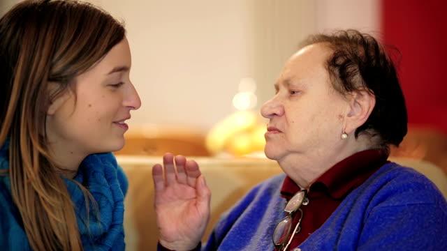 Grandmother kissing her granddaughter video