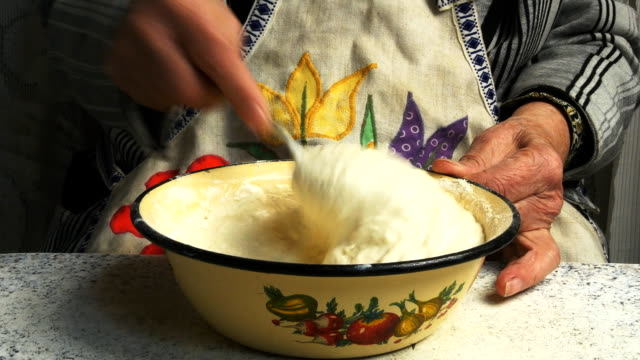 Grandmother kneads the dough video