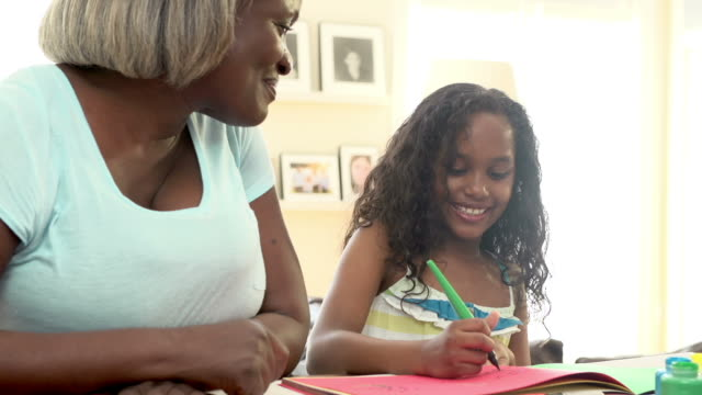Grandmother Painting Picture With Granddaughter At Home video