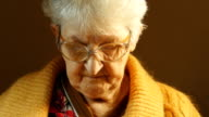 Grandmother reading a book. video