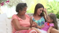 Grandmother With Granddaughter And Daughter In Garden video