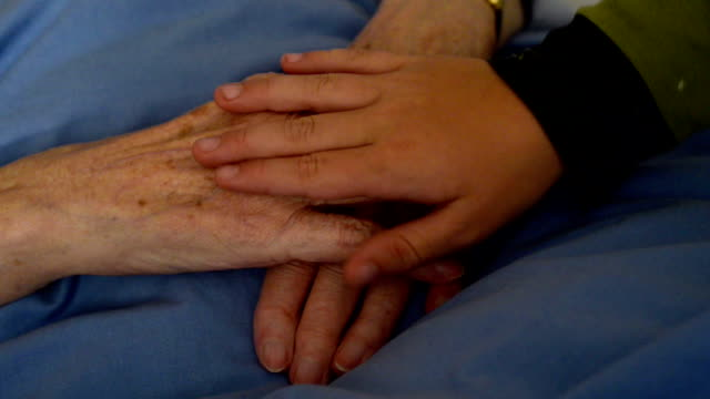 Grandmother's and grandchild's hands video