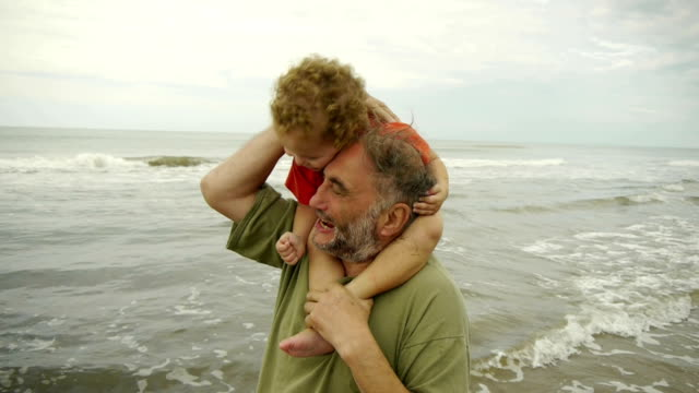 Grandpa & Grandson playing at the beach - Shoulder Ride video