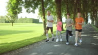 SLO MO TS Grandpa and grandma jogging with grandchildren video