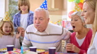 SLO MO grandpa blowing out the candles on his cake video