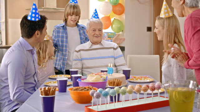 Grandpa getting surprise cake for birthday from his family video